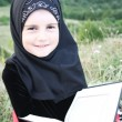 Young adorable Islamic girl - Stock Photo