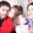 Stock Photo: Mother and father with children