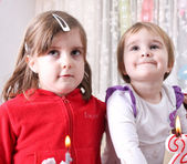 Two girls with birthday cake — Stock Photo