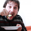 Happy man eating — Stock Photo