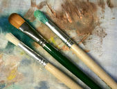 Three brushes on fabric — Stock Photo