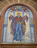 Fresco over church entrance — Stock Photo
