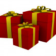 Three red gift boxes with yellow ribbon — Stock Photo
