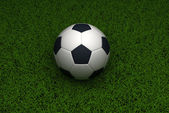Soccer ball on grass background — Stock Photo