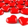 Many red hearts isolated on white — Stock Photo