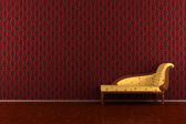 Classic sofa in front of red wall — Stock Photo