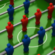 Stock Photo: Foosball table with red and blue players
