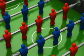 Foosball table with red and blue players — Stock Photo