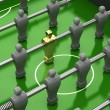 Stock Photo: Foosball table with gold player