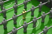 Foosball table with gold player — Stock Photo