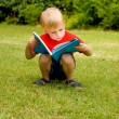 The boy with the book — Stockfoto