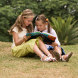 Stock Photo: Two schoolgirls on nature