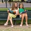 Stock Photo: Two schoolgirls on park