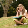 Schoolgirl on  nature - Stockfoto