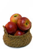 Apples in basket, isolated on white — Stock Photo