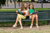 Two schoolgirls on park — Stock Photo