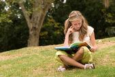 Schoolgirl on nature — Stock Photo