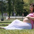 Royalty-Free Stock Photo: Pregnant happy young woman in park