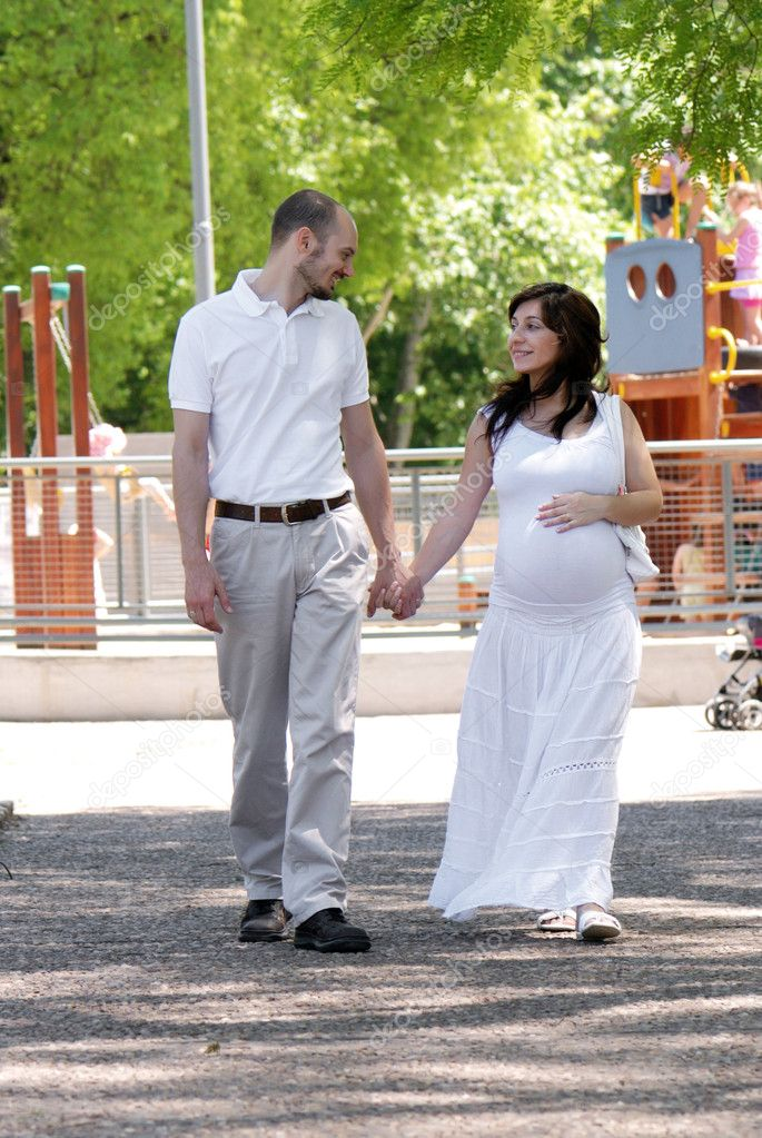 Happy beautiful pregnant woman and her husband  Stock Photo #1779811