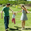 Happy family on walk in park - Stock Photo