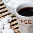 Cup of black coffee and Sugar — Stock Photo #1947429