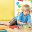 The little boy with books — Foto Stock