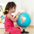 Royalty-Free Stock Photo: The little girl with globe