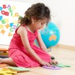 Stock Photo: Little girl with Letters
