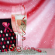 Glasses with champagne and Gift — Stock Photo
