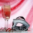 Champagne and venetian mask - Stock Photo