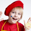 Small artist in a red beret - Stock Photo