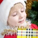 Small Santa Klaus with gifts — Stock Photo