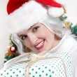 Christmas woman in santa hat — Stockfoto
