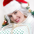 Christmas woman in santa hat — Stock fotografie