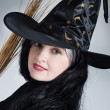 Stock Photo: Portrait of a cute witch with hat