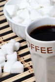 Cup of black coffee and Sugar — Stock Photo