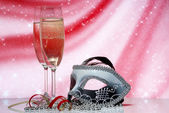 Champagne and venetian mask — Stock Photo