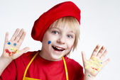 Small artist in a red beret — Stock Photo