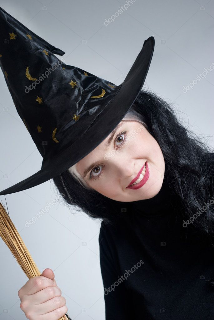 Portrait of a cute witch with hat — Stock Photo #1948103