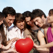 Стоковое фото: Group of young guys and girls