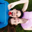 Young, a loving couple lying on a grass — Stock Photo #1950191