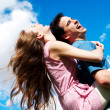 Happy Young couple against the sky — Stock Photo