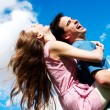 Stock Photo: Happy Young couple against the sky