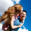 Happy Young couple against the sky — Stock Photo #1950204