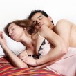 Royalty-Free Stock Photo: Young couple sleeping together in bed