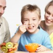 Stock Photo: Happy family has breakfast