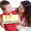 Happy family with a gifts — Stock Photo #1951266