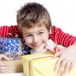 Stock Photo: Little boy with gifts