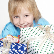 Little boy with gifts — Stock Photo