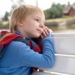 The dreaming little boy on a bench. — Stock Photo #1952343